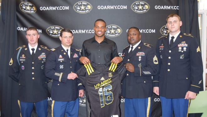 Timber Creek senior wide receiver Cameron Chambers was presented a replica jersey honoring his selection to the U.S. Army All-American Bowl.