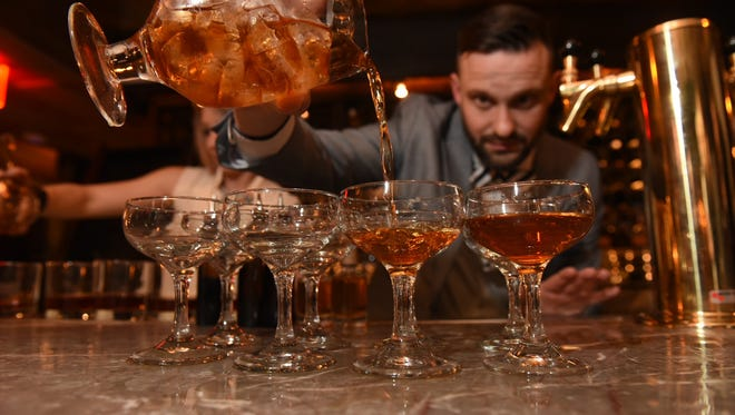 Jonathan Howard pours his winning recipe on his way to the championship at the Woodford Reserve Manhattan Experience in New York.