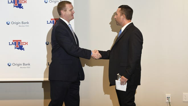 Louisiana Tech athletic director Tommy McClelland, left, introduces new baseball coach Lane Burroughs on Wednesday in Ruston.