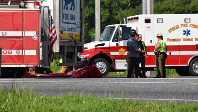 Authorities investigate the scene Sunday, July 31, of a crash on eastbound Route 50 at Racetrack Road involving a truck and a tractor trailer. One person was confirmed dead.
