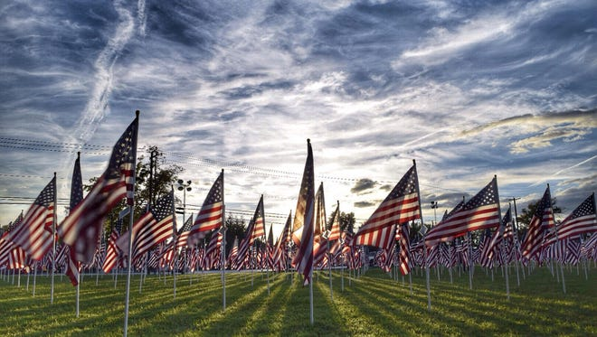 """Mark McIntyre of New Oxford submitted this photo to the Evening Sun News and Community gallery Sep. 13. McIntyre writes, """"Sunset on the flags at the Healing Field, West Manheim Elementary."""""""