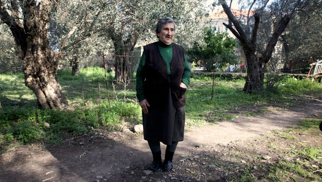Emilia Kamvysi, candidate of the Nobel Peace Prize, outside her house.