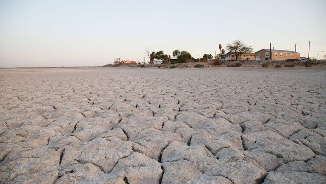 Homes in West Shores, Calif., look out over the exposed lakebed of the Salton Sea.