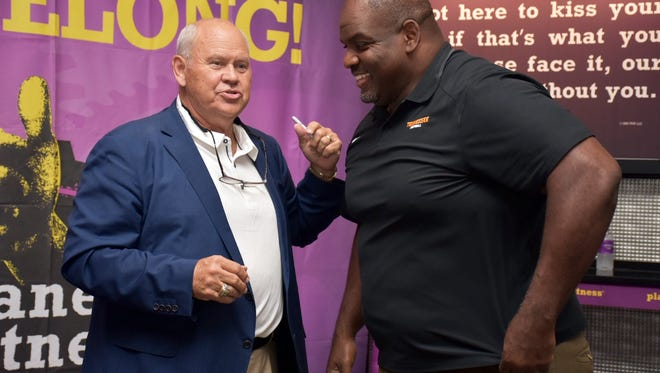 Phillip Fulmer and Antone Davis prepare to greet guests at the 2017 grand opening of Planet Fitness in Farragut.