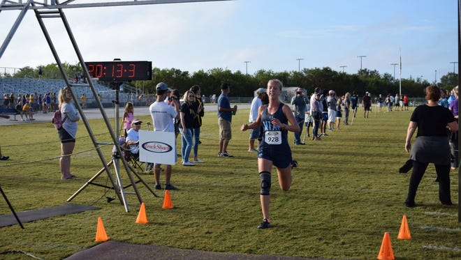 Marco Island's Olivia Watt crosses the finish line at the North Port Invitational last month. Watt, a state qualifier last year, wants a spot on the podium this year.