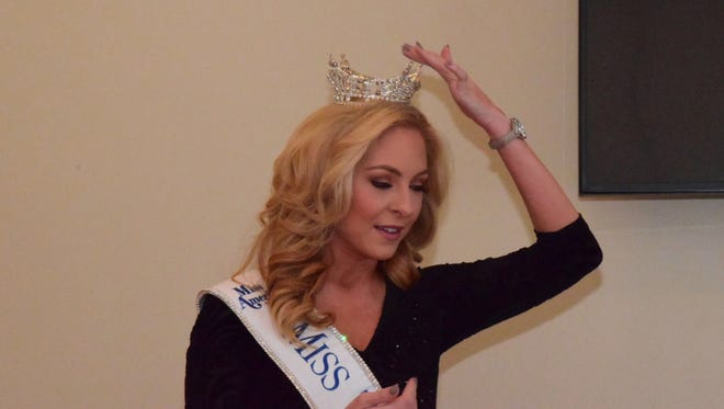 """Caty Davis explains that the four tips of her crown represent service, success, scholarship and STEM education. """"I'm not just a blond pageant girl. I want to talk to these kids across the state and hopefully make a difference to them."""""""