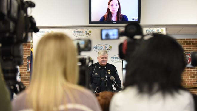 Police Chief Dave Hall talks during a press conference Thursday to discuss a 2004 investigation after reports Brianne Randall-Gay, shown via Skype, involving Larry Nassar.
