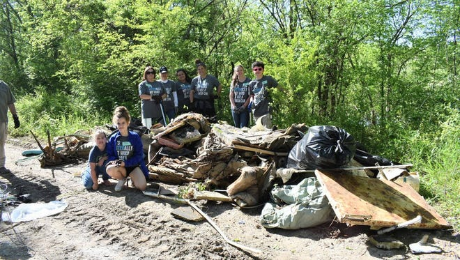 The City of Clarksville and the Cumberland River Compact joined forces April 29 to clean a section of the Red River in preparation for a new walking trail.