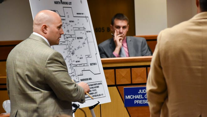 Detective Brad Tucker, left, with the Billings Police Department, describes a standoff between police and Frank Joey Half Jr. last November as Lewis and Clark County coroner Bryan Backeberg looks on Wednesday June 20,2018, at the Yellowstone County Courthouse in Billings, Mont. An inquest was being held to determine if Half's killing by officers was justified. (AP Photo/Matthew Brown)