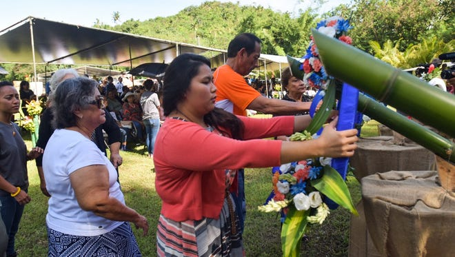 Wreaths are presented by Manenggon Memorial Foundation board members during the 74th Manenggon Memorial Commemoration in Yona, July 8, 2018.