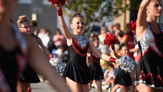 Members of the Starlites Dance Team from the Huron Physical Arts Center perform during the Rotary International Day Parade Wednesday in Port Huron. The name of the team was incorrect on an early photo.