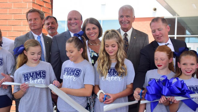 Several Hardin Valley Middle School cheerleaders along with County Mayor Tim Burchett and other dignitaries cut the ribbon on the new Hardin Valley Middle School Tuesday, July 10. Pictured front from left are Ashlee Ferguson, 12, Kennedy Crateau, 12, Savannah Cody, 12, Megan Winters, 11, Mia Holloway, 11; back, Burchett, Commissioner Randy Smith, Commissioner Brad Anders, school board member Terry Hill, Superintendent Bob Thomas, and Hardin Valley Middle School principal Cory Smith.