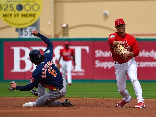 St. Louis Cardinals shortstop Aledmys Diaz turns a