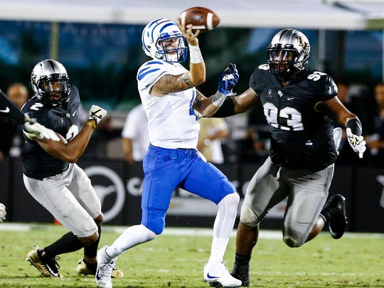 Memphis quarterback Riley Ferguson (middle) throws an incomplete pass against  Central Florida during the second quarter Saturday, Sept. 30, 2017.