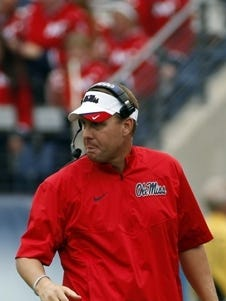 Mississippi head coach Hugh Freeze walks back to the sideline in the first quarter of an NCAA college football game against Vanderbilt Saturday, Sept. 6, 2014, in Nashville, Tenn. (AP Photo/Mark Humphrey)