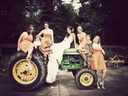 Ellie Day and her bridal party on a John Deere. The