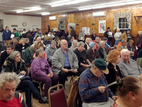 Neighbors from Farrington's Mobile Home Park in Burlington pack the community room at the Heineberg Senior Center on Tuesday.