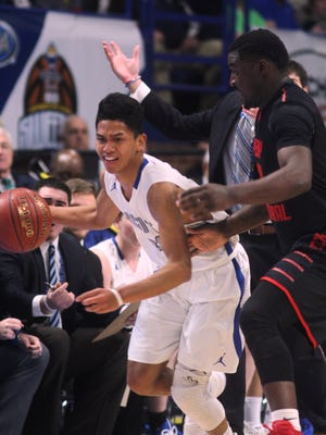 Scott senior Vincent Dumlao pushes ahead in transition during Scott's KHSAA Sweet 16 boys basketball state quarterfinal vs. Perry County Central March 17, 2017 at Rupp Arena in Lexington KY.