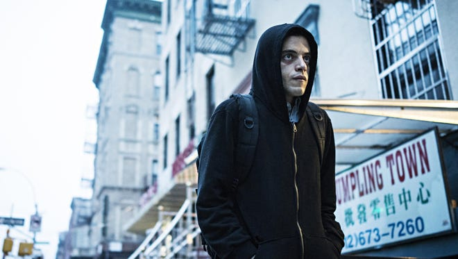 "This image released by USA Network shows Rami Malek in a scene from ""Mr. Robot."" USA Network announced the fourth and final season of the award-winning series will return in 2019."