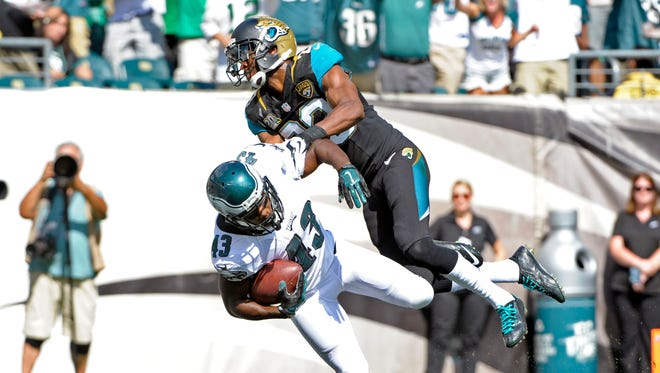 Philadelphia Eagles running back Darren Sproles (43) scores on a 49-yard touchdown run against Jacksonville Jaguars cornerback Alan Ball (23) in the third quarter at Lincoln Financial Field. Mandatory Credit: Eric Hartline-USA TODAY Sports