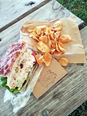 From the Dapper Pig--a chicken salad sandwich on their bubbly house focaccia with truffle parmesan chips.