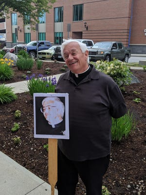 Father Agapit Jean Jr.  was honored in Dover for his 25th anniversary.