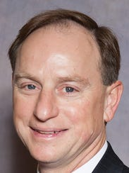 John R. Schnitzer of SEK & Co. was reappointed to the