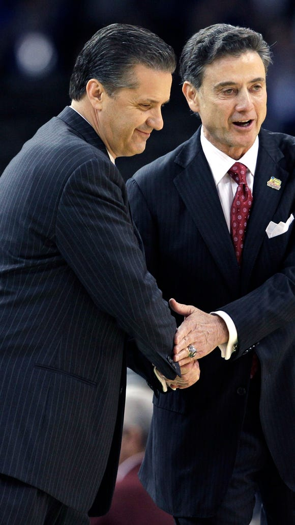 In this March 31, 2012, file photo, Louisville head coach Rick Pitino, right, shakes hands with Kentucky head coach John Calipari before their Final Four game in New Orleans.