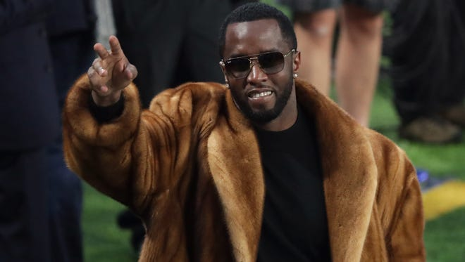 "Rapper Sean ""Diddy"" Combs waves to the crowd during warm-ups prior to Super Bowl LII between the New England Patriots and the Philadelphia Eagles at U.S. Bank Stadium on February 4, 2018 in Minneapolis, Minnesota."