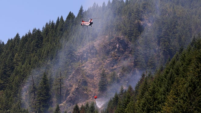 A wildfire that was burning July 4 on Highway 22 near Big Cliff Dam is now 100 percent contained.