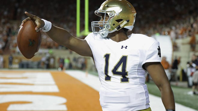 AUSTIN, TX - SEPTEMBER 04: DeShone Kizer #14 of the Notre Dame Fighting Irish celebrates scoring a 29-yard rushing touchdown during the third quarter against the Texas Longhorns at Darrell K. Royal-Texas Memorial Stadium on September 4, 2016 in Austin, Texas.