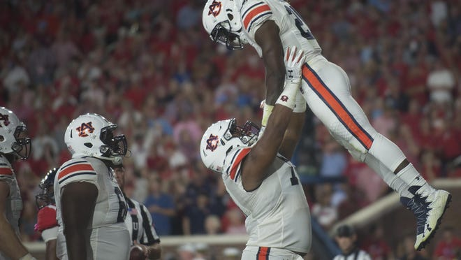 Auburn running back Kerryon Johnson (21) is lifted in the air after scoring a touchdown during the NCAA football game between Auburn and Mississippi at Vaught-Hemingway Stadium on Saturday, Oct. 29, 2016, in Oxford, Miss. Albert Cesare / Advertiser