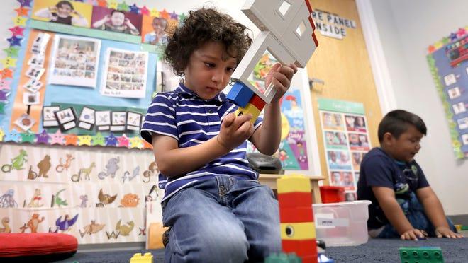 Saaraim plays with LEGO pieces at Utah Community Action Program Head Start in Salt Lake City on Wednesday, July 18, 2018.