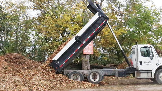 An employee for the City of Fairbury dumps leaves onto a pile on West Locust Street, a sure indication that fall is here and that winter is on its way.