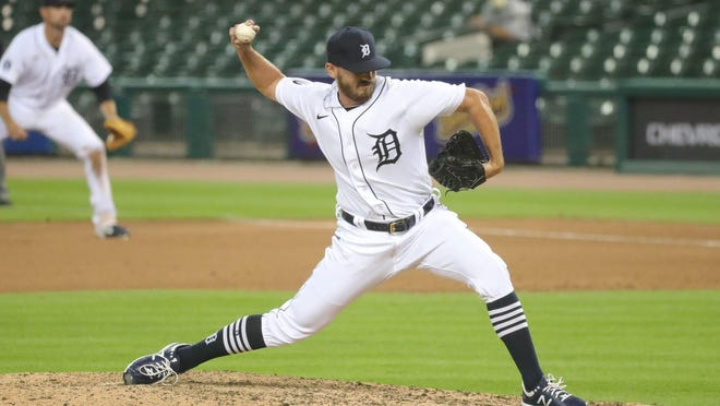 Gibraltar Carlson graduate John Schreiber pitches the eighth inning during the Detroit Tigers' 14-6 loss to Kansas City Monday night.