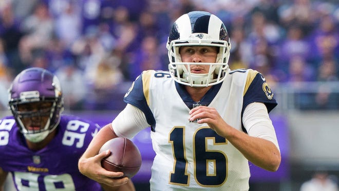 Los Angeles Rams quarterback Jared Goff (16) scrambles in the second quarter against the Minnesota Vikings at U.S. Bank Stadium.