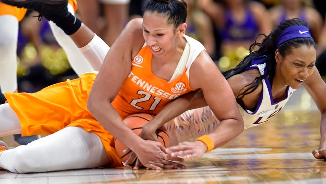 Tennessee center Mercedes Russell (21) dives on the floor to recover the ball she knocked loose from LSU guard Chloe Jackson (0) during the fourth quarter Sunday.