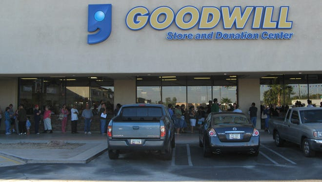 Shoppers line up outside of a Goodwill located at the southeast corner of Litchfield Road and Van Buren Street.