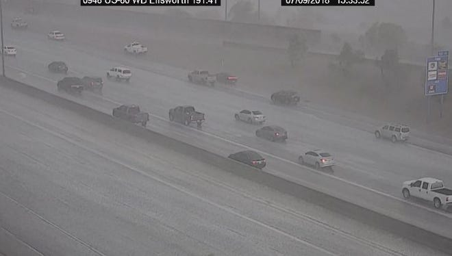 Heavy rains fall over the US 60 freeway Monday afternoon as seen by an Arizona Department of Transportation freeway camera.