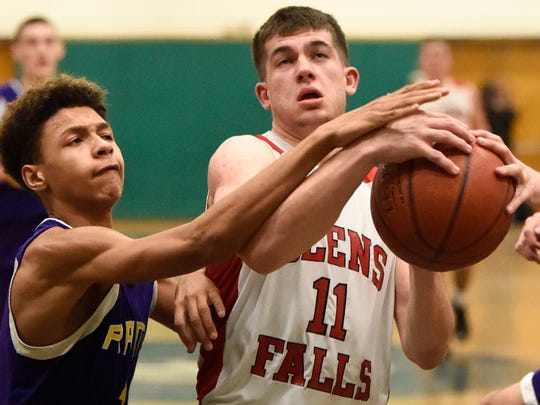 Joseph Girard III of Glens Falls is fouled by William Brown of Amsterdam at SUNY Adirondack in Queensbury on Feb. 14, 2017.