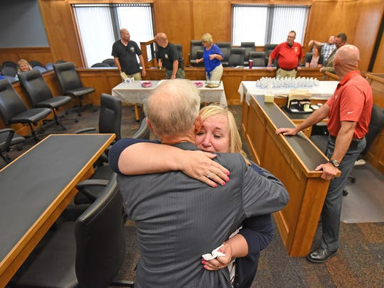 Judge James DeWeese hugs Pam Myers on Thursday afternoon after talking about her service during her retirement party.