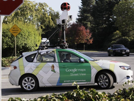 In this Oct. 27, 2010 file photo, an employee drives a Google Maps Street View vehicle around Palo Alto, Calif.