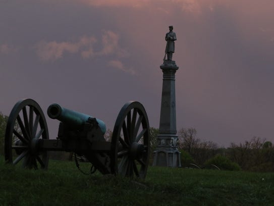 The battlefield at Gettysburg at dusk as a storm rolls