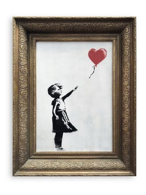 "The original ""Girl with Balloon: by artist Banksy, which self-destructed in front of startled auction-goers on moments after being sold for $1.4 million."