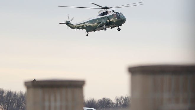 "Marine One, with President Donald Trump aboard, lands at Dover Air Force Base, Del. Wednesday, Feb. 1, 2017. Trump traveled to Dover AFB to meet with family members Chief of Special Warfare Operator William ""Ryan"" Owens, 36, of Peoria, Ill, the U.S. service member who was killed in a raid in Yemen, and who's remains where returned today. Owens is the first-know combat death of a member of the U.S. military under Trump's administration."