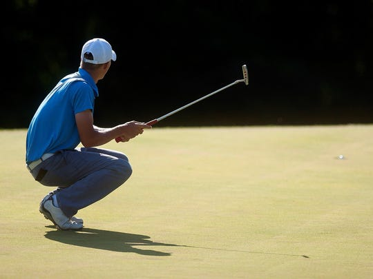 Troy Evans reacts as his par putt drops on the 17th