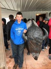 Columbus FFA member, Garret Baerwolf at a Bison Farm