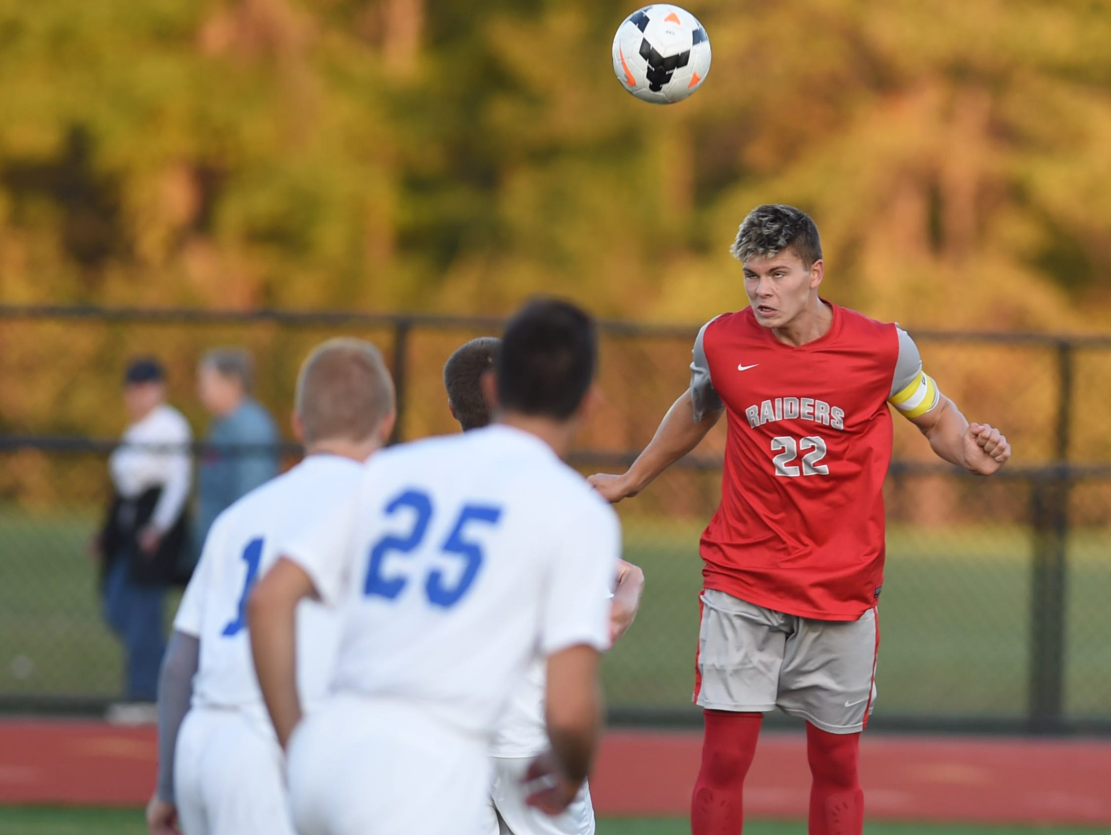 Red Hook's Zach Sivulich headers the ball past a line of Wallkill's players during Tuesdays Mid-Hudson Athletic League Semi-Final held in Staatsburg.