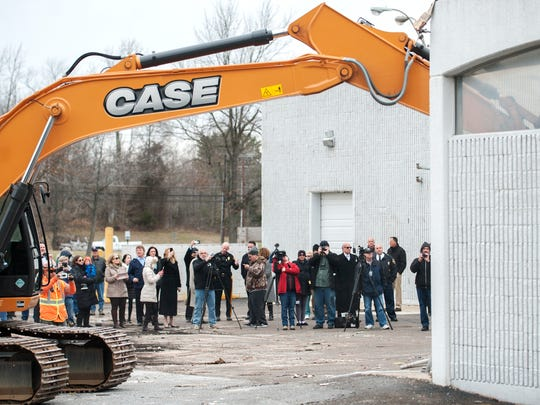 A crowd watches as part of the old Kmart building in the Tri-Towne Plaza in Evesham is torn down Tuesday as part of The Shoppes and Residences at Renaissance Square redevelopment project.