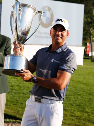 Jason Day poses with the trophy after winning the BMW Championship at Conway Farms Golf Club.
